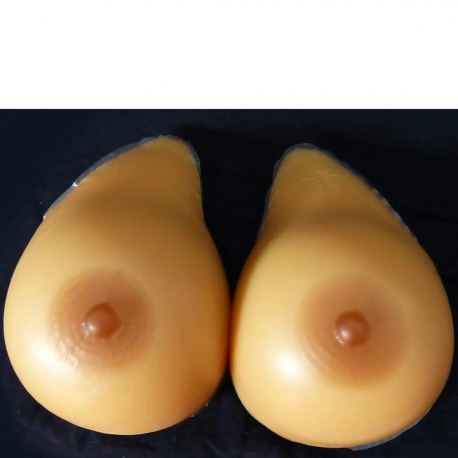 Asymmetrical silicone busts, Self-adhesive breasts