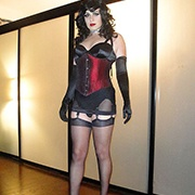 Trans woman in corset with stockings.